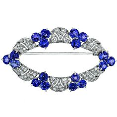 Sapphire Diamond Platinum Brooch. This platinum brooch features diamonds and blue sapphires. There are 74 round diamonds that weigh 1.40cttw, and 18 sapphires that weigh 16.65cttw. 20th century