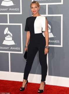 Style queen: Beyonce was clad in a stylish geometricjumpsuit by b Osman, which she teamed with a Swarovski clutch bag and Lorraine Schwartz jewellery