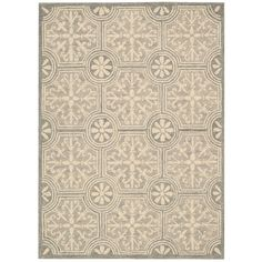 This large neutral-colored area rug features an attractive tiled design in gray and tan. Soft cotton-wool hand-tufted construction is easy on bare feet, and a tough latex backing prevents slips and falls.