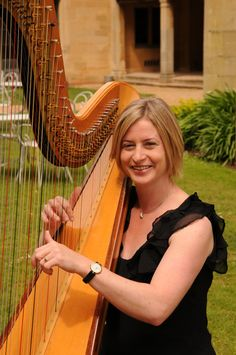 Emily Mullins playing Harp at Coombe Lodge - beautiful accompaniment for either inside or garden ceremonies, or drinks reception www.emilymullins.co.uk