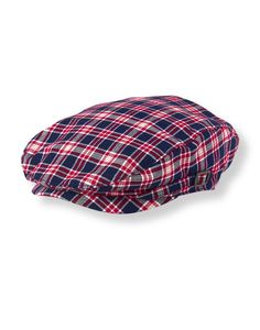 Preppy plaid stands out on our cap in airy cotton poplin. Charming piece is detailed with side buckle accents and an elasticized back.