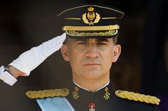 Spain's newly crowned King Felipe VI review troops at the Parliament in Madrid, Spain, Thursday June 19, 2014.
