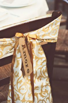 "Pretty fabric + ""amore"" tags for chair decor."