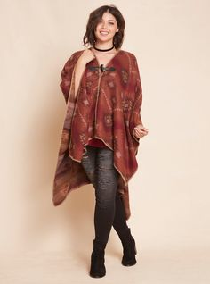 """This silky-soft, bordering-on-cashmere ruana wrap is totally down to earth with a rust colored knit printed with a Southwestern-inspired geo print. A toggle closure keeps the look fitted.<div><br></div><div><b>Model is 5'10"""", size 1<br></b><div><ul><li style=""""LIST-STYLE-POSITION: outside !important; LIST-STYLE-TYPE: disc !important"""">One size</li><li style=""""LIST-STYL..."""