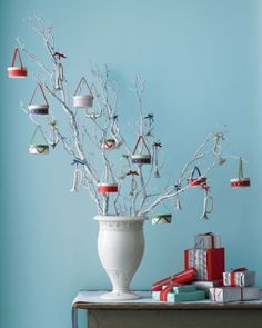 Natural branches, spray paint any color.  Homemade drum ornaments.