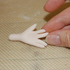 Close Up on Decorator's Fingers Molding Fondant Fingers A Very Handy Modeling Hand Tutorial