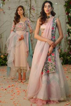 Product Description: Aisha is an intricately embroided waistcoat with silk bustier, paired up with flowy and summery pastel colour chevron print skirt very soft organza summer shawl with delicate floral bunches on the borders. Designer Bridal Lehenga, Bridal Lehenga Choli, Indian Attire, Indian Ethnic Wear, Indian Wedding Outfits, Indian Outfits, Indian Designer Outfits, Designer Dresses, Dress Indian Style