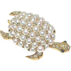 A charming turtle brooch to wear on a lapel or ambling across your shoulder. This wonderful little creature has an articulated head which moves from
