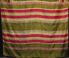 An Indian 1920s/30s fine silk saree with a green ground, deep burgundy stripes and a delicate block printed pattern. More photos on www.kilim.ie