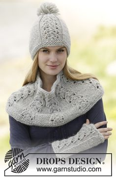 """Set consists of hat with pompom, neck warmer and wrist warmers with lace pattern in """"Eskimo"""". #knitting by #DROPSDesign"""