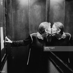 I love this pic so so much. Carrie Fisher giving a kiss to her own reflection.