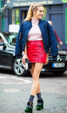 Pink top, red leather skirt, navy bomber and green platform sandals with grey socks!