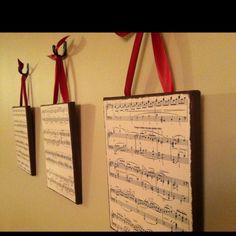 Wall art: canvas, sheet music on cardstock, matte mod podge. Staple ribbons to back. Sponge paint sides. Voila!