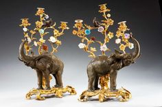 Splendid pair of bronze and gilt bronze elephant candelabras with rococo flowers and foliage with birds in the branches, England c. 1950