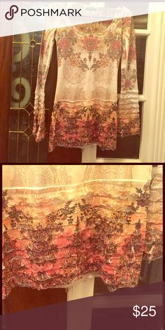 Long sleeve shirt Very soft, ruffled, floral print shirt; has normal wear; see material on ends that create unraveling (this can be cut off); 65% polyester, 35% cotton; size S; bought at a boutique Color in Motion Tops Blouses