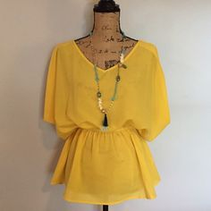 Yellow cold shoulder top by Ya Lightweight canary yellow top with open shoulder.  Looks great casual with jeans or shorts or with a skirt for a dressier look. Worn once so in excellent condition😊 Ya Los Angeles Tops Blouses
