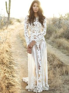 18 Romantic Bomemian Chic Summer Wedding Dresses for The Modern Boho Princess: Gorgeous long sleeve lace boho chic summer wedding dress by Zuhair Murad