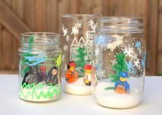 These DIY snow globes for kids are so fun! Use your LEGOs and don't worry about spilling water . . . there isn't any in this craft!