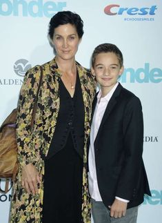 """Celebs and their cute kids in Carrie-Anne Moss and son Owen attended the premiere of """"Wonder"""" in Los Angeles on Nov. Carrie Anne Moss, Canadian Actresses, Eva Mendes, Reese Witherspoon, Celebs, Celebrities, Cute Kids, Carry On, Fashion"""
