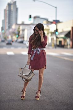 If you're looking for a simple way to spruce up a shirt dress outfit, why not try copying Paola Alberdi's decision to tie a belt around your waist to create definition and a more pronounced silhouette. We love this simple trick! Shoes: Matches Fashion, Bag: The Real Real.
