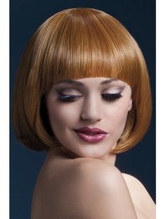 Auburn short bob with fringe. Heated styling tool compatible. Heat resistant up to 120 degrees celcius to 248 degrees fahrenheit. Fully adjustable wig cap for secure fit. Professional quality synthetic wig. Overall length 10 inches.