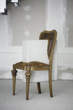 studio nucleo melds dramatic concrete blocks with antique furniture  www.designboom.com