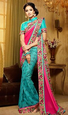 Be under spotlight wearing on this turquoise and pink color georgette silk half n half sari. The ethnic lace and resham work within suit adds a sign of elegance statement with your look. #embroideredbordersaree #floralworksaris #reshamworksari