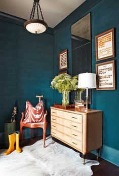 A mirror is a smart addition to a tiny entryway. This decorative accessory helps define the drop-zone and, by reflecting light, makes the space appear larger. #entryway #entrywaydecor #smallentryway #entrywaywall #bhg Pale Blue Walls, Teal Walls, Dark Teal, Vintage Interior Design, Vintage Design, Interior Colors, Interior Design Colleges, Blue Rooms, Blue Bedroom
