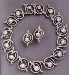 Known as the Kent Pearl Swirl tiara or necklace this convertible piece has had 2 of the swirl elements removed to make earrings, as seen in the picture and is mostly now worn as a necklace
