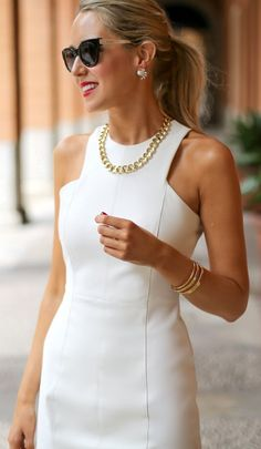 white sheath dress with gold jewelry