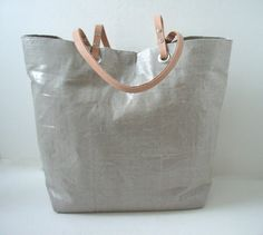 Tote Bag, Metallic Silver Linen with Natural Leather Handles, Casual Tote Bag, Vacation Tote, Beach Bag,  Everyday Bag, Market Tote, Women. $138.00, via Etsy.