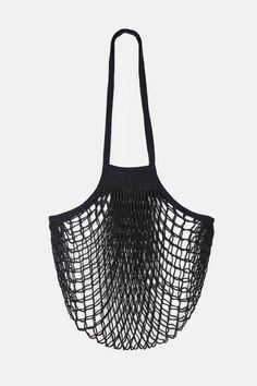 Originally made for fisherman, net bags known in France as filet were later adopted for mainstream use as featherweight, flexible totes for everything from groceries to laundry. Ours is woven by Normandy-based Filt, a small company that has been making nets, ropes, and candle wicks in the town of Caen since 1855. Soft and expandable in black cotton, this bag stows away easily for travel and is comfortable to sling over the shoulder even when filled to the brim.
