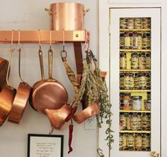 Read these organizing tips and organizing ideas for how to store pots and pans in your kitchen on Domino. Learn the right way to store pots and pans in your kitchen. Tidy Kitchen, Copper Kitchen, Kitchen Storage, Spice Storage, Kitchen Ideas, Kitchen Rack, Kitchen Gadgets, Pot Storage, Kitchen Cabinets