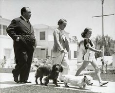Very rare photo...He was such a shy man!  Alfred Hitchcock and his family go for a walk in Bel-Air, Los Angeles, 1940