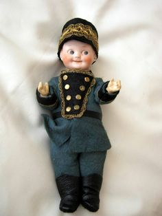 Marked : Armand Marseille 324/ 11/0. Rare antique doll soldier. wears a beautiful green very detailed felt uniform with brass bottoms, removable matching braided hat and black leather boots. Lovely smily painted face, nostrills, red dots to corner of the eyes, painted impish eyes and painted hair. | eBay!