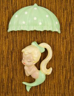 If youre a fan of vintage chalkware and love mermaids, then you need to own a piece of Barbie Ks amazing reproduction chalkware! This two piece set features a little blonde mermaid with a purple bow in her hair and a purple tail. She mea. Mermaid Bathroom Decor, Mermaid Wall Decor, Mermaid Cove, Mermaid Fairy, Mermaid Barbie, Vintage Love, Vintage Stuff, Kitsch, Vintage Antiques