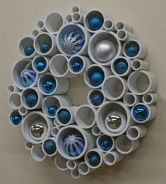 Spring Wreath - PVC Wall Art The balls look more like Christmas ornaments to me but it certainly gives you an idea how it can be decorated for different occassions. Holiday Crafts, Christmas Crafts, Christmas Decorations, Christmas 2019, Christmas Ornaments, Autumn Decorations, Holiday Wreaths, Diy Wall Art, Diy Art