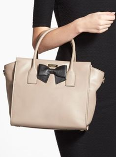 leather satchel with a sweet bow  http://rstyle.me/n/p2w4npdpe