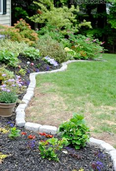 the perfect border for your beds defining a garden s edge with stone, concrete masonry, flowers, gardening, outdoor living, raised garden beds