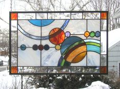 Galaxy 1 -- 21.75 x 13.5--Stained Glass Window Panel In this panel I have inclulded an interesting design concept of circles and arcs suggesting planetary interaction. I have used a wide variety of bright colors. The background is a white opal streaky glass that is bordered by