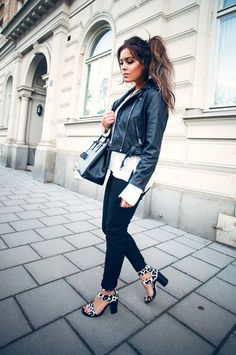 How To Style A Black And White Outfit: Fanny Lyckman is wearing a Minusey leather jacket, a long sleeved Zara shirt with a pair of Gina Tricot trousers