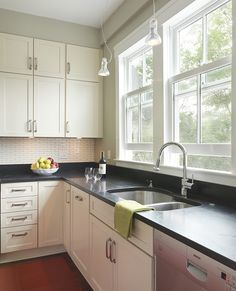 Living With Kids: Cory Kallfelz (I love the big windows over the sink, the light cabinets, wooden floors, even the small subway tile backsplash!)