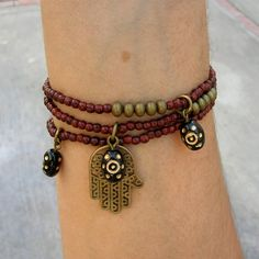 Rosewood mala bracelets with Hamsa hand and hand painted evil eye charms