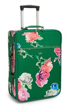 Ready to travel in style with this pretty green and floral Kate Spade suit case.