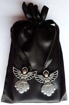 http://www.ebay.com.au/itm/Silver-Angel-Charm-Black-Satin-Tarot-Pouch-Bag-/331577852552?pt=LH_DefaultDomain_15