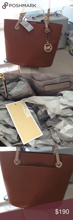 """New Michael Kors tote 15""""-9.5"""" $248 originally New with tags 4 bucket in side and zipper in side. Bucket on the back Michael Kors Bags Totes"""