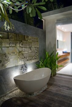 rocks and lighting behind tub, tile where wood is?