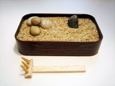Mini Zen garden made from an Altoids tin-cute!