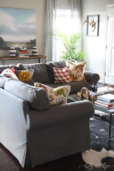 Williams Home | Holly Mathis Interiors - love the dark gray couch, cowhide? rug, big painting, curtains...um, okay, all of it!!