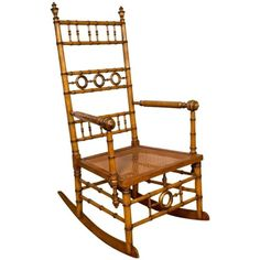 A spindle design rocking chair, part of a rare collection of late 19th century golden stained bird's-eye maple faux bamboo bedroom furniture.